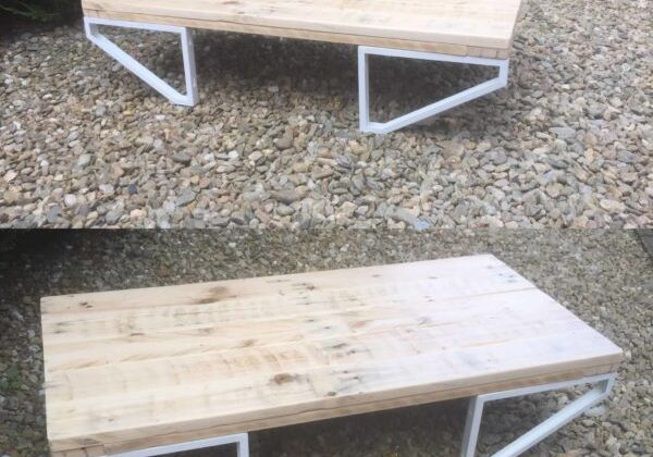 Combine store-bought table legs or brackets to create a modern feel on a shoestring budget. This table would be gorgeous in your living room or in your outdoor living spaces! An excellent DIY Pallet Project for sure!