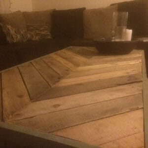 A beautiful reclaimed pallet wood table built in a chevron pattern